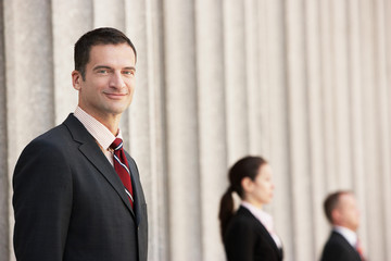 Confident attorney outside courthouse, portrait