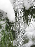 silvery Christmas chain on snowy coniferous tree poster