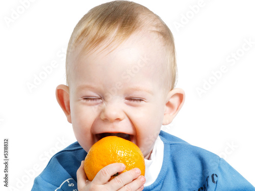 Trying to bite orange