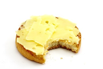 Cracker with butter and dutch cheese isolated on white
