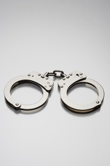 Handcuffs on white background in studio