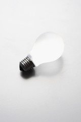 Light bulb on white background in studio