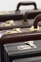 Row of briefcases in studio