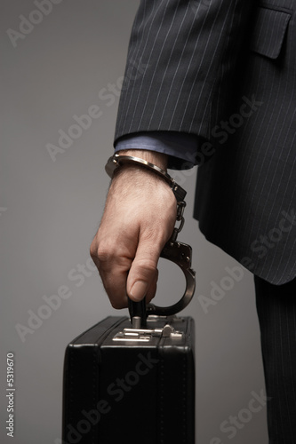 Briefcase Handcuffed to Businessman's Wrist