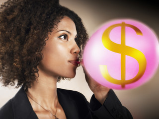 Businesswoman Blowing Money Bubble