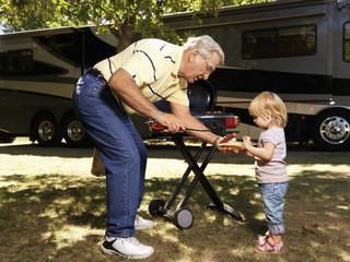 Man and child  with hotdog.