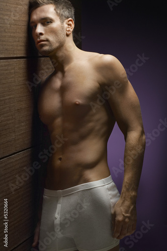 Man wearing underwear, indoors, portrait