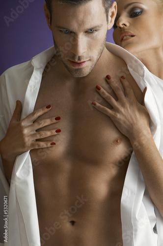 Woman embracing man, close-up, portrait