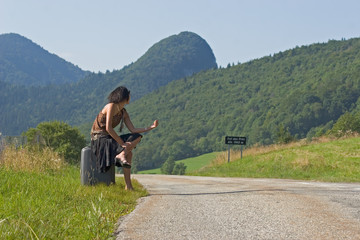 Woman making of hitch-hiking