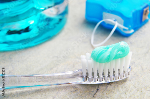 Closeup of a tooth brush, with floss and rinse - 5327278