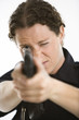 Policewoman aiming gun.