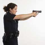 Policewoman aiming gun. poster