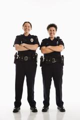 Policewomen crossing arms.