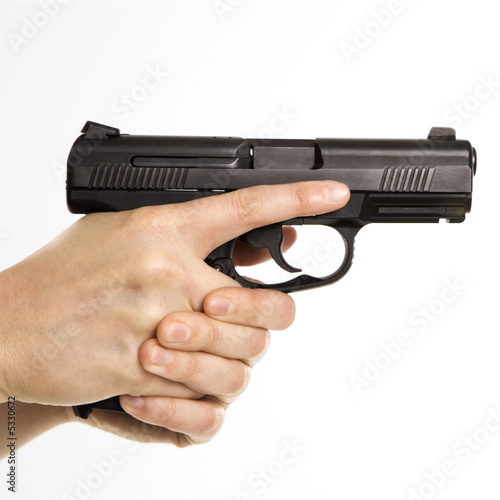 Female holding handgun.