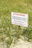 Sign warning visitors not to disturb natural dune area. poster
