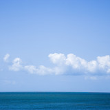 Ocean and sky with low cumulus clouds. poster