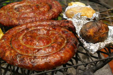 Sausages and potatoes in foil