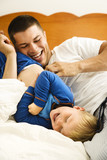 Dad tickling child. poster