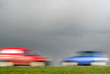 red and blue car, racing towards eachother poster
