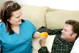 Home health nurse gives her patient his medicine. poster