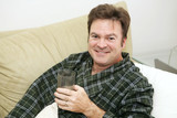 Man home sick from work drinking  fluids poster