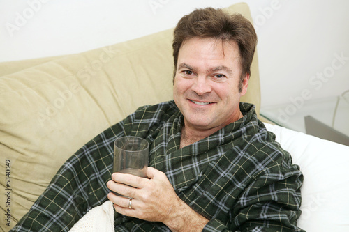 poster of Man home sick from work drinking  fluids