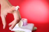 Moisturizing cream on red background poster