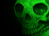 Halloween mask on black with green lighting effect poster