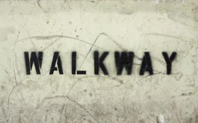walkway stencilled on new york wall