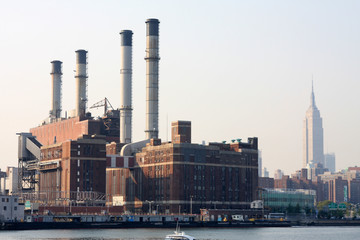 power plant with nyc buildings in background