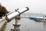 a viewing telescope at lake luzern poster