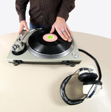 shot of hand of male dj scratching turntables poster