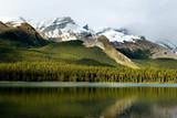 nadian Rockies mountain range reflecting in Maligne lake poster