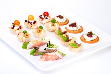 Tray with ready-to-eat fresh sandwiches on holiday table