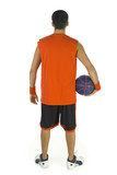 Young basketball player standing backwards