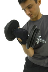 Young man exercising arms muscles with dumbbell