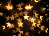 Gold stars bokeh background poster