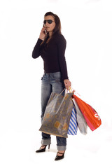 Young brunette girl holding bags and calling