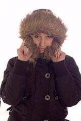 Young girl wearning winter jacket with hood