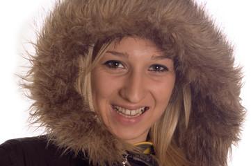 Happy girl wearning winter jacket with hood