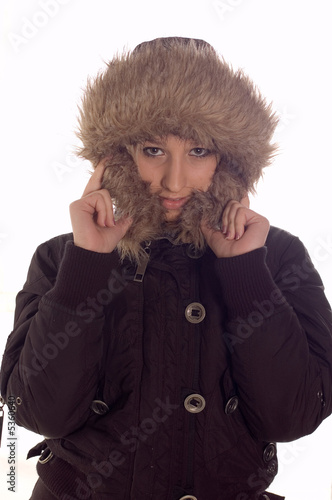 Young girl wearning winter jacket with hood