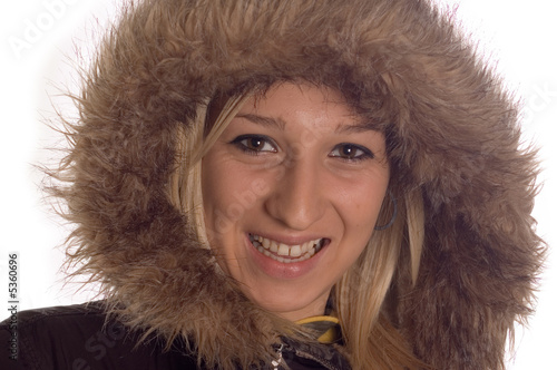 Happy girl wearning winter jacket with hood