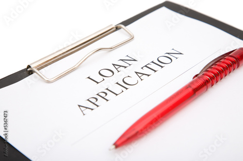 business loan application form with red pen on white background