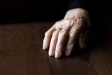 wrinkled hand of old woman  poster