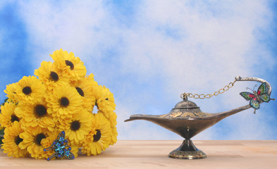 Antique Oil Lamp and Yellow Flowers