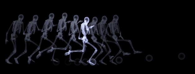 Xray of human skeleton playing soccer