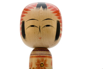 Japanese Kokeshi doll close-up on white background