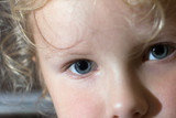 Small girl facial close - up portret (indoor) poster