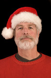 Pleasant middle-aged bearded man in a santa hat poster