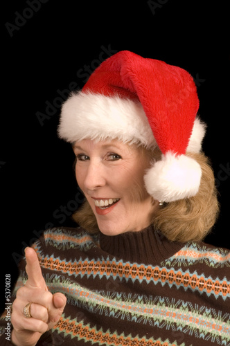 Attractive middle-aged womanman in a santa hat